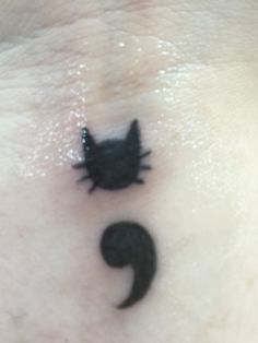 Here's an up close picture of my first tattoo. It's a cat semicolon.                                                                                                                                                      More