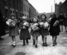 March Children who are small enough to pass under an archway in Bow in the east end of London qualify for a weekly parcel of toys. (Photo by Harry Todd/Fox Photos/Getty Images) Vintage London, Old London, Carleton Watkins, Jungle Music, New York To Paris, East End London, Punk Princess, Vintage Photos, The Past