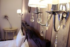 Bratescu Mansion Sparkling Diamond or room number will introduce you to an eclectic atmosphere with floral motifs and lamps adorned with crystal elements. Brasov Romania, Sparkling Diamond, Wall Lights, Ceiling Lights, Luxury Rooms, Sconces, Chandelier, Sparkle, Boutique