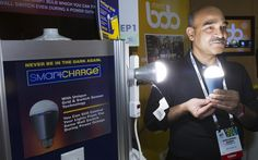 Considering the powers outages across the UK over the last few weeks, this innovation could prove very useful. Founder Shailendra Suman poses with a SmartCharge LED lightbulb. The bulb, which retails for $25.00 (approx £15.25), has a rechargeable battery and will give about four hours of light during a power cut Picture: STEVE MARCUS/REUTERS