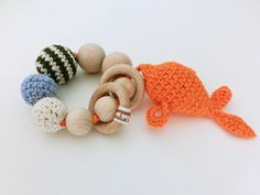 Crochet baby teether and rattle fish - orange. Inspired by One Dog Woof ❤️ Baby Teethers, Crochet Baby, Crochet Necklace, Fish, Orange, Dog, Inspired, Inspiration, Diy Dog