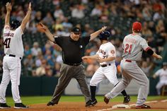CrowdCam Hot Shot: Umpire Wally Bell calls Houston Astros second baseman Jose Altuve safe against Cincinnati Reds third baseman Todd Frazier during the first inning at Minute Maid Park. Photo by Thomas Campbell