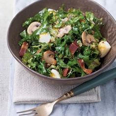 A riff on the classic warm spinach-and-bacon salad, this recipe features thin ribbons of kale instead.