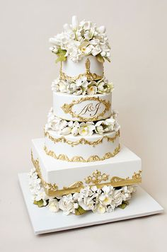 An elegant wedding cake from Ron Ben-Israel Cakes showcases gilded details and fabulous sugar flowers.