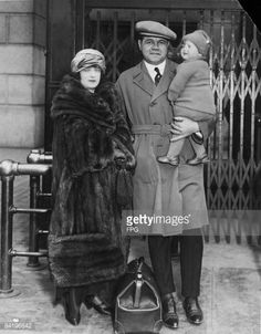 American baseball player Babe Ruth (1895 - 1948) (born George Herman Ruth Jr) poses at Pennsylvania Station with his wife Helen Ruth (nee Woodford, 1897 - 1929) and daughter Dorothy Ruth (later Dorothy Sullivan and Dorothy Pirone, 1921 - 1989), as he prepares to leave the Yankees spring training camp, New York, New York, early 1923.