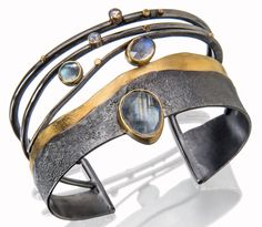 Moonstone Reef cuff bracelet in oxidized silver and 18k and 22k gold with rainbow and faceted moonstones, $2,640; Sydney Lynch