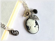 Black cameo necklace in silver tone setting by MacKenziesAttic, $10.00