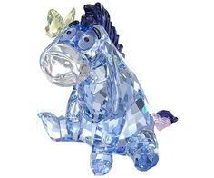 Disney - Eeyore - Gifts - Swarovski Online Shop ($299.00) - With big Jet crystal eyes, lovable Eeyore shines in Light Sapphire Silver Shade crystal with a Dark Indigo mane and tail tip. A delicate Jonquil crystal butterfly flutters on his ear. Why not combine this charming figurine with his friends Winnie the Pooh, Piglet, and Tigger? Decoration object. Not a toy. Not suitable for children under 15. Approximate size: 3 5/8 x 2 15/16 x 2 3/4 inch Article no.: 1142842