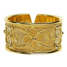 Damaskos Rope Flower Split Back Band Ring, 18k Gold. http://www.athenas-treasures.com/products/Damaskos-Rope-Flower-Split-Back-Band-Ring.html.  This and more handmade Greek jewelry at Athena's Treasures: www.athenas-treasures.com