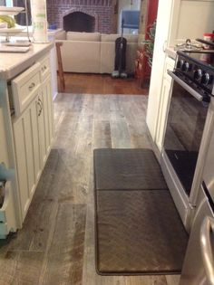 "Porcelain tile that looks like aged barn wood. Available at Lowe's. We love it in our kitchen! called Natural Timber Ash -- used Pearl Gray Sanded Powder Grout and added Grout Boost Stain-Resistant Grout Additive; 3/16"" grout line. http://www.lowes.com/ProductDisplay?productId=50106830&CAWELAID=320011480002288242&cm_mmc=sm_pi-_-richpins-_-Tile&Stone-_-50106830="