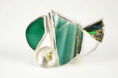 Work - Deborrah Daher, Brooch, fine and argentium silver, 22k and 18k yellow gold, malachite, Australian boulder opal, porcelain shard.