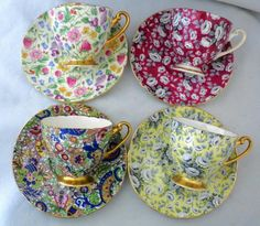 SET OF 4 CHINTZ TEACUPS & SAUCERS, RED TAPESTRY ROSE, YELLOW TAPESTRY ROSE, BLUE PAISLEY & COUNTRYSIDE