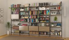 Drop-dead gorgeous library wall bookshelf with our wood laminate modular shelving and several walnut cabinets. I could be in this room for hours!
