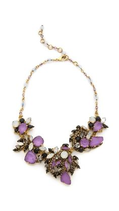 A delicate Erickson Beamon necklace shimmers with colorful, iridescent Swarovski crystals along the chain and cluster bib.