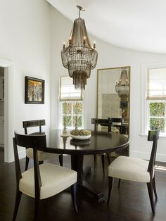 transitional dining room by Kathleen Bost Architecture + Design...love the mirror