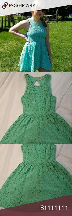 Adorable Lace Skater Dress YOU DON'T HAVE TO FIGURE THE PRICE, I'VE ALREADY DONE IT FOR YOU. PRICE DISPLAYED IS AT LEAST 20% OFF ORIGINAL PRICE.! THIS DRESS IS DARLING! GUC  It has two buttons around the neck but an otherwise open back.  My daughter is 5' 3 and this dress hits her above mid thigh.  Dress is Teal in color and in GUC. I have two listings for this dress. Dresses Mini