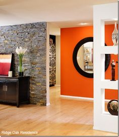 orange accent wall... I'm definitely having one in my future home!