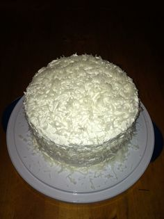 Sour Cream Coconut Cake 1 Betty Crocker Cake mix 8oz sour cream  8oz cool whip 3/4-1 cup powered sugar  Cream of Coconut 12-14oz Coconut Bake cake as directed in 2 round pans,cool. Mix sour cream,cool whip,sugar & coconut. Taste during mixing to add the amount of sugar desired. Place the first layer on cake plate poke holes with opposite end of wooden spoon, add 1 teaspoon cream of coconut to each hole. Ice that layer, add next layer, repeat with cream of coconut & icing. Chill for at least 24hr Sour Cream Coconut Cake, Coconut Icing, Poke Cakes, Candy Cookies, Wooden Spoon, Betty Crocker, Cake Plates, Baking Ideas, Beautiful Cakes