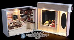 Miniature dollhouse chocolate shop. I LIKE this approach - closed it will keep the dust out (quarter inch is painfully hard to dust - and open it allows full appreciation of the details! Nicely done!