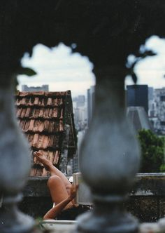 He couldn't see her very clearly but he knew it was her. His heart skipped a beat when she set her book down and he thought she saw him but then she picked her book back up and continued reading
