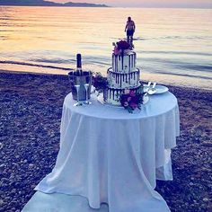 Wedding in Crete -  Perfect cake cutting on the beach . 3 tier naked chocolate cake with fresh flowers an extra special cake topper.  www.royalblueevents.gr
