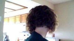 Short curly bob cut from behind