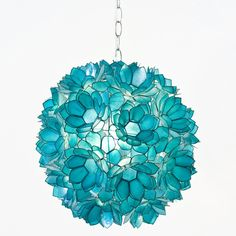 Playful and pretty, this Venus hanging pendant lives up to its name with clusters of sweet flowers forming a ball. The lotus petals made fro...