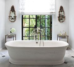 If I ever could get rid of the big ol' garden tub...I love this freestanding tub, flat on the floor...no clawfeet