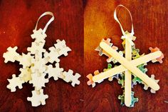 DIY snowflake puzzle piece ornament. Made with Popsicle sticks, white paint, glitter, puzzle pieces, ribbon, and hot glue. Perfect on your Christmas tree.