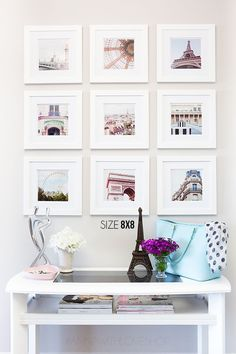 White frames, square frames, square pictures. pictures of places we've traveled to.