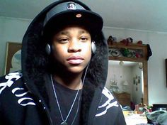 Stereotypical black teenager, hoodie, headphones, flat rim sports hat