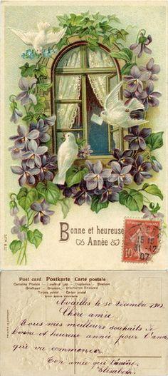 Bonne et heureuse Année - Fenêtre entourée de volettes, trois colombes, une apporte une missivee, une autre du myosostis - 1907 (from http://mercipourlacarte.com/picture?/359)