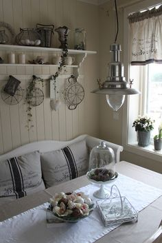 Blue and White linen cushions and curtains with old fashioned lamp create the most beautiful country kitchen  - #Country #Kitchens