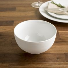 These simple white porcelain bowls are perfect for any decor. Durable porcelain construction is dishwasher safe and great for everyday family meals or special occasions.