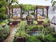 rooftop in Manhattan, great seating with canopy, tile floor, even a tree in a pot!