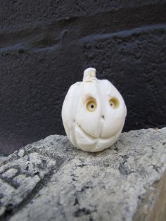 Bitty Pumpkin by Oxide Pottery. Porcelain clay and underglaze- fired to cone 6 in an electric kiln
