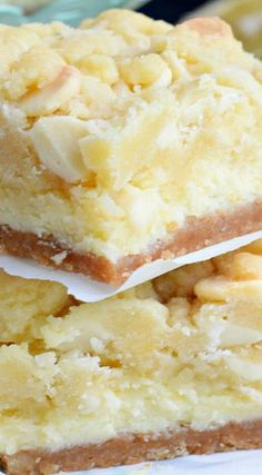 Cheesecake Bars ~ Layers of cookie crust, lemon cheesecake and lemon cookie bars. One of the most delicious desserts everLemon Cheesecake Bars ~ Layers of cookie crust, lemon cheesecake and lemon cookie bars. One of the most delicious desserts ever Lemon Desserts, Lemon Recipes, Köstliche Desserts, Baking Recipes, Sweet Recipes, Delicious Desserts, Bar Recipes, Recipies, Healthy Dessert Recipes