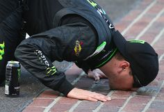 Kyle Busch, #54, celebrates by kissing the bricks after winning the NASCAR Nationwide Series Indiana 250 at Indianapolis Motor Speedway on 7/27/13.