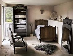 I love this old bed, and I LOVE the open armoire for blankets!