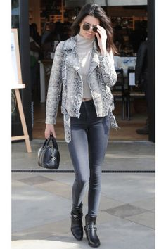 50 turtleneck outfit ideas to wear this fall and winter: Kendall Jenner layers a gray turtleneck under a snakeskin moto jacket with skinny jeans and ankle boots.