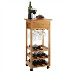 Basics Serving Cart by Winsome. $70.62. Assembly Required: Yes. Product Dimensions: 15 in x 15 in x 33 in. Wine Cart with Glass Rack, Drawer, Holds 9 Bottles. Finish: Light Oak. 34333 Features: -9-bottle wine rack.-Wheeled for easy transport.-Storage drawer. Color/Finish: -Oak finish. Dimensions: -Dimensions: 33'' H x 15.25'' W x 15.2'' D.. Save 58%!