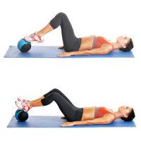 Footwork on Ball: Lie faceup, arms by your sides, palms facing down. Bend your knees and place the balls of your feet on top of the ball, heels together and toes pointing slightly outward in a small V shape. Engage your core and contract your glutes to lift your hips an inch off the floor, then roll the ball away from you until your heels are on the ball. Pause, then bend your knees to roll the ball back to the starting position.
