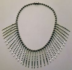 Another Inspiration for a DIY.Anni Albers,Necklace, ca. 1940.35 bobby pins on metal plated chain.©2003 The Josef and Anni Albers Foundation / Artists Rights Society (ARS), New York here.