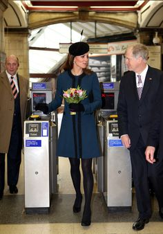 "Kate Middleton with the Queen.  The Underground gave her the ""Baby on Board"" pin as she is pregnant in this photo."