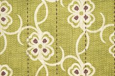 Carharrack Floral Cotton Curtain Fabric Lovely moss green cotton fabric with off white and purple interlinking floral print coupled with a subtle dotted stripe. Suitable for curtains and domestic upholstery.