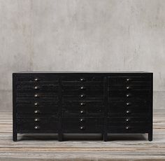 RH's Printmaker's Sideboard:Inspired by a newspaper letterpress workshop, our collection replicates the industrial look of type case cabinets, whose wide, shallow drawers are used to organize typographic characters. We've reconfigured this classic design for the home, increasing drawer space without sacrificing style.
