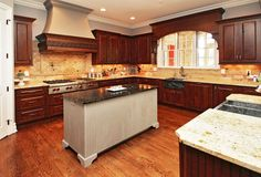 Traditional kitchen with solid wood cabinets, soapstone island and granite countertops