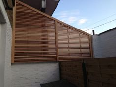Western Red Cedar fence screen to hide some nasty glazing in Clapham. Posted by Hacienda Landscapes