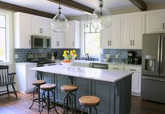 Use smaller subway tile than this, lighter blue, glass cabinet