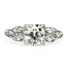 Rawlins is an amazing vintage Art Deco engagement ring centering a 0.83ct Transitional Round Brilliant cut diamond accented by marquise shaped diamonds on both sides. Lovely! TrumpetandHorn.com // $6,250